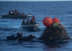 Closeup of Orion capsule being recovered following EFT-1