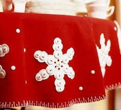 Snowflake Felt Tablecloth for a Christmas Table (also could decorate a tree skirt or stocking like this)  http://www.bhg.com/christmas/crafts/snowflake-felt-tablecloth-for-christmas/