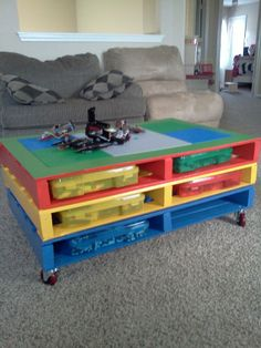 Lego table made from pallets... Easy peasy, but where do I get the pallets?  I would add a couple more pallets to make it taller - standing kids height, maybe a few stools.