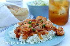 Fresh shrimp, cooked in a spicy Creole tomato sauce and served over a bed of hot steaming rice. Served here with my cucumber salad and hot French bread.