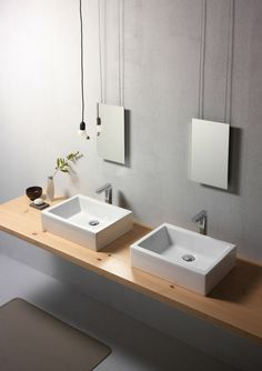 GSI ceramic | KUBE 50/T is a countertop washbasin glazed on all the visible surfaces. A washbasin that thanks to its clean lines without an overflow tap and a versatile tap system can be combined with any type of bathroom style.  #GSIceramica #BathroomDesign #Washbasins