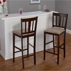 Give your home breakfast bar or kitchen space a fresh new look with this pair of contemporary wood bar stools. This set is crafted from rubberwood with a trendy espresso finish and has a softly padded microfiber seat for luxurious comfort.