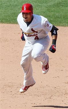 St. Louis Cardinals' Yadier Molina celebrates after driving in the game-winning run with a single in the ninth inning against the Chicago Cubs in a baseball game Tuesday, May 15, 2012, in St. Louis. The Cardinals won 7-6. (AP Photo/St. Louis Post-Dispatch, Chris Lee) EDWARDSVILLE OUT ALTON OUT