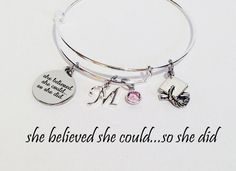 This cute graduation bracelet would make a perfect graduation gift. Great personalized gift for a high school graduation gift or college graduation gift. The round stainless steel charm has the words she believed she could...so she did. Measurements: 3/4 x 7/8 or 19mm x 22mm. The bracelet is personalized with the graduates initial and birthstone or favorite color and a zinc alloy graduation cap charm. Please see 3rd and 4th photos for swarovski birthstone colors and initial charms. ...