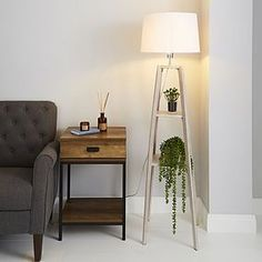Wide range of Floor Lamps available to buy today at Dunelm, the UK's largest homewares and soft furnishings store. Natural Floor Lamps, Natural Wood Flooring, Modern Floor Lamps, Modern Lighting, Lighting Design, Floor Lamp With Shelves, Wood Floor Lamp, Black Floor Lamp, Floor Lamp Shades