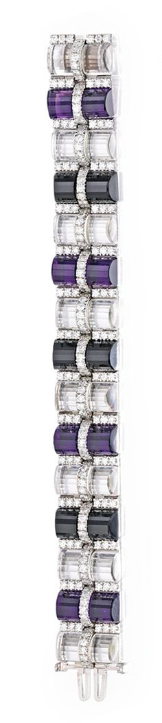18 KARAT WHITE GOLD, ROCK CRYSTAL, AMETHYST, ONYX AND DIAMOND BRACELET, ALETTO BROTHERS.  Of articulated design, composed of eight fluted rock crystal columns alternating with four fluted amethyst segments and three fluted onyx segments, accented by round diamonds weighing approximately 9.90 carats, length 7 inches, signed Aletto Bros.