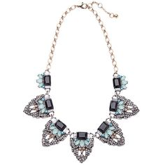 Featuring shades of both navy and light blue the Almaz necklace ups the drama by covering every surface with crystals. Perfect for holiday parties or to dress up a more casual look, who wouldn't want