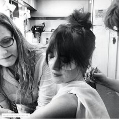 Dakota Johnson on the set of Fifty Shades Of Grey. Getting her tattoo's covered up.
