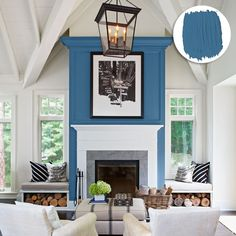 Ocean blue adds definition to this well-trimmed fireplace wall and invites seating to draw around it, campfire style. The vibrant shade, coupled with clean white, also helps balance the high-profile ceiling beams and chandelier. | @behrpaint Neptune Blue