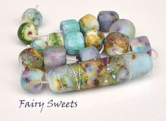 LAMPWORK BEADS - most are silver drenched, gumdrop sweet colors of blues, seafoam, violet and purple _Patricia Ritchie‎