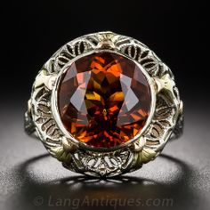 Vintage Citrine and Two-Tone Filigree Ring.  #jewelry A fiery, faceted, round, amber-orange Madeira citrine emits an electric sparkle from within a tri-color gold filigree setting. The 1930s vintage ring is die-struck and hand finished with five (somewhat unusual versus the common six) decorative compass points.