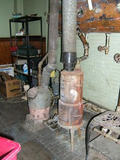 Old water heater. Walter K. Parker's Old School Plumbing Dudley, MA #plumbingartifacts