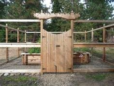Deer-resistant fence guarding raised wooden garden boxes - now if I can get hubby to build it...