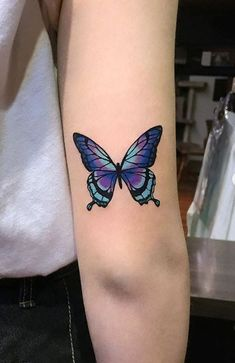 butterfly tattoo on foot / butterfly tattoo - butterfly tattoo designs - butterfly tattoo small - butterfly tattoo sleeve - butterfly tattoo meaning - butterfly tattoo behind ear - butterfly tattoo arm - butterfly tattoo on foot Butterfly Tattoos On Arm, Colorful Butterfly Tattoo, Butterfly Tattoo Meaning, Butterfly Tattoo Designs, Dragonfly Tattoo, Purple Tattoos, Pretty Tattoos, Cute Tattoos, Skull Tattoo Design