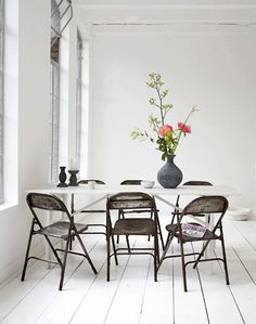 sara sjogren. i think these metal folding chairs have to be one of the most affordable space...