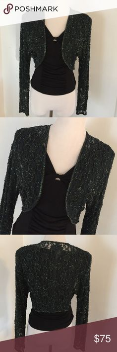"""💯VINTAGE SEQUINED ELEGANT CROP SHRUG 🌹HP🌹 This is such a deep forest green it appears black lace with sparkling sequins in pattern throughout and around seams. Absolutely amazing over a LBD but also makes a statement over a black tank with jeans! No labels - shoulder to sleeve 27""""; back Sean length 14""""; under arm 16"""" across flat; bottom 14"""" across flat and open as shown in first picture. Words cannot describe the beauty! Any questions please ask! As always ✅Offers accepted! Tx for…"""