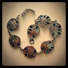 Sand Dollar Silver Bracelet with Blue Gems Beautiful sand dollar bracelet with Faux Blue Abalone gems in each sand dollar. 7 1/2 inches with closed clasp Jewelry Bracelets