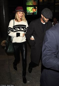 Just landed: Rosie Huntington-Whiteley was spotted at LAX on Saturday walking arm in arm with her long time boyfriend actor Jason Statham