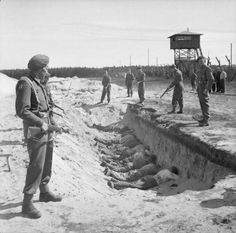 German SS guards, exhausted from their forced labour clearing the bodies of the dead at Bergen-Belsen, are allowed a brief rest by British soldiers but are forced to take it by lying face down in one of the empty mass graves, 1945 Rare Historical Photos, Rare Photos, Old Photos, Famous Photos, Vintage Photos, History Books, World History, World War Ii, History Museum