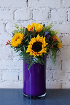 Some new purple and lime green vases to add to our collection, what do you think? These are from a company in London that specialise in designer glassware for florists. We love their vases, the vibrant colours really compliment the flowers. #reidsflorists #corporateflowers #designervases