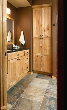 rustic hickory bathroom vanity Cabinets: Rustic hickory appears again in this lowerlevel bath Rustic Bathroom Vanities, Bathroom Vanity Cabinets, Rustic Bathrooms, Bathroom Floor Tiles, Bathroom Ideas, Tile Floor, Rustic Vanity, Bath Cabinets, Bathroom Colors