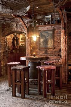 Man Cave: The use of rustic brown bar stools and table with the exposed brick is very masculine energy. It's only for the man, no women allowed here!