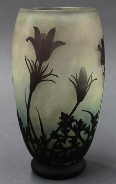 """DAUM Nancy Art Nouveau cameo glass vase, the tapered form decorated w/ aubergine violets cut to an ombre mottled ground from cream to sea green, marked Daum Nancy w/ the Cross of Lorraine, 8""""h (hva)"""