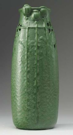 """WELLER Matt Green vase with reticulated poppy design around rim. (Shown in an interior photograph in """"Amercan Arts & Crafts from the Collection of Alexandra and Sidney Sheldon,"""" Palm Springs Desert Museum, California, by Katherine Plake Hough, 1993, p. 13.) Unmarked. 13 1/2"""" x 5"""""""