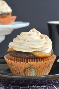 These chocolate cupcakes with a pumpkin cheesecake center and white chocolate cinnamon frosting are perfect for any fall party. .