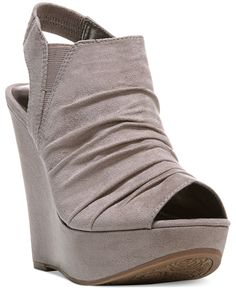 Turn some heads in this chunky style. The Britton platform wedge sandals by Carlos by Carlos Santana.