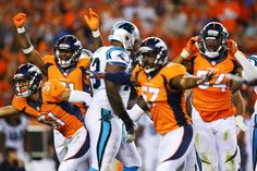 Todd Davis #51, Justin Simmons #31, Dekoda Watson #57, and Brandon Marshall #54 of the Denver Broncos celebrate a missed field goal at the end of the game against the Carolina Panthers at Sports Authority Field Field at Mile High on September 8, 2016 in Denver, Colorado.