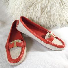 "Tory Burch BRAND NEW driving moccasins Tory Burch BRAND NEW driving moccasins in a fun bright orange leather and linen textile.  Rubber grips also add a nice comfort.  Only tried on a few times never outdoors  they are in excellent condition.  Gold ""T"" logo at toe. States size 8 1/2 feel these would fit 8 best. Insole measures 9 1/4"" long Tory Burch Shoes Flats & Loafers"