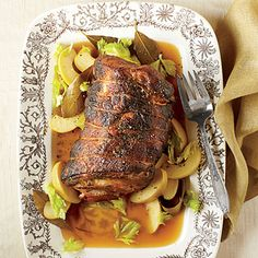 Cider-Braised Pork Shoulder | If you want to dress up the humble pork shoulder roast, ask your butcher to butterfly it. Sprinkle the spice rub all over both sides of pork; roll and tie it with kitchen string before browning.