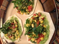 Raw Jicama tostadas topped with veggies and cilantro lime and Serrano chile dressing