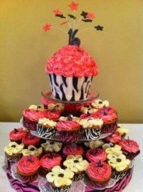 16th birthday cake and cupcakes