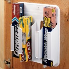 Kitchen Wrap 'n Bag Organizer to a cabinet or pantry door to sort out and store rolls of cling wrap, aluminum foil, and waxed paper as well as boxes of sandwich and freezer bags. $9.99, organizing a pantry is a must @Julie York