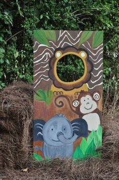 One Wild Party:  Zoo Themed Extravaganza - View 2   Every party needs a place for a photo op, and this head cutout board is PERFECT. Grab a piece of plywood, cut a face hole, paint on your favorite animals and your guests will be entertained for hours.