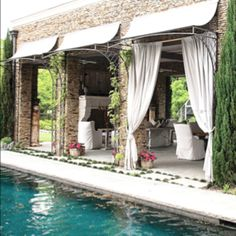 Pool house, look at those awnings.  Needing something for our  outdoor kitchen area.  This would be perfect!