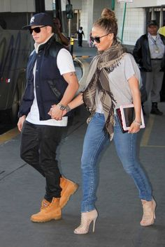 Jennifer Lopez in True Religion.  This whole look down to the tight high bun is an A+!!!!