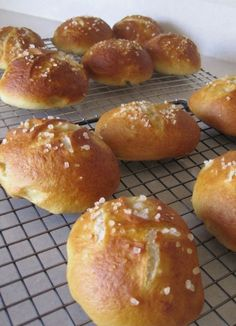 Soft Pretzel roll recipe  1-1/3 cups warm water  2 tablespoons warm milk  2-1/2 teaspoons active dry yeast  1/3 cup light brown sugar  2 tablespoons butter, melted  4 cups all-purpose flour  Kosher salt or Pretzel salt  2 quarts cold water  1/2 cup baking soda    Directions  In the bowl of a standing mixer fitted with a dough hook, mix 1/3 cup warm water with the yeast and let stand until foamy. Pretzel Roll Recipe, Pretzel Bread, Pretzel Rolls, Pretzel Bites, I Love Food, Good Food, Yummy Food, Pan Focaccia, Croissants