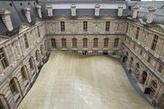 Golden carpet at the Louvre by Rudy Ricciotti and Designer Mario Bellini.