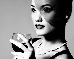 One or two glasses of wine can make the drinker look more attractive to others, a new study finds.