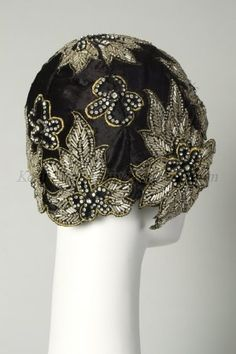 1920, ca. / Hat, black velvet with clear glass beads and rhinestones in flower form outlined in gold.