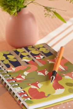 Fox-Themed Notebook. A sly way to get baby shower guests to leave notes for the baby-to-be.