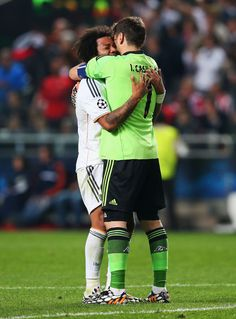 Marcelo of Real Madrid celebrates victory with Iker Casillas of Real Madrid during the UEFA Champions League Final between Real Madrid and A...