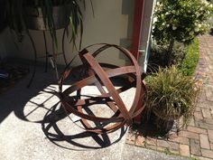 SImple - just 5 wine barrel rings and you have garden art!