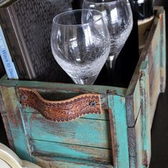 Decorate Creatively with Old Wooden Crates...love the recycled belt handles!