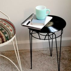I'd likely change the bottom/base...but I love this idea...it's funkiness, quirkyness, retro & unexpected : )  Tutorial for an upcycled DIY side table made using a vintage record.