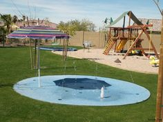 What a great idea instead of a pool have a small splash pad. Safer and saves space. YES!!!! DREAM KID BACKYARD!