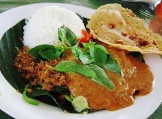 INDONESIAN NASI PECEL (Rice With Peanut Sauce and Peanut Chips | Traditional Meal From Java.